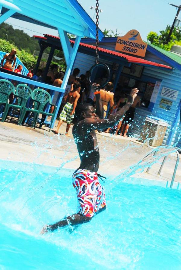 Soldier swings on traveling rings at Summer Fun Park - Belton, TX